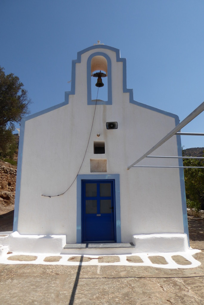 The little white church of St. Anarguris at 'Sto Makrinó', the threshold upon which aged oxen were slaughtered