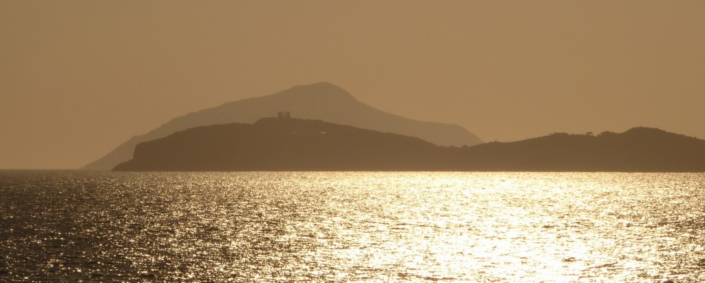 Temple of Poseidon at Sounion with Mount Hymettus in the background